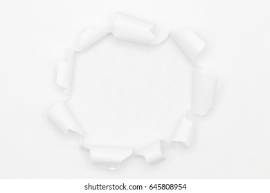 White torn paper on white background