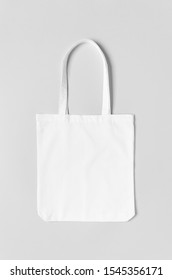 White tote bag mockup on a grey background.