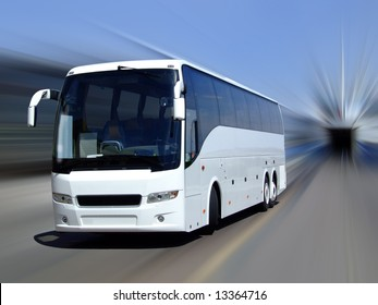 A white tour bus set against a motion blurred background
