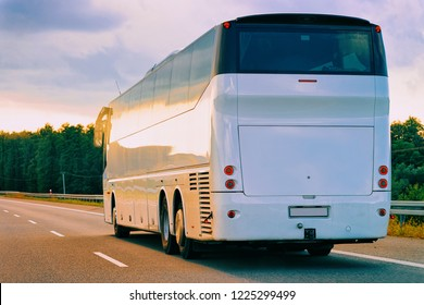 White Tourist bus in the highway road in Poland. Travel concept.