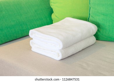White towel fold on hotel resort bed