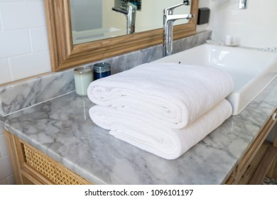 White towel fold on sink counter in bathroom