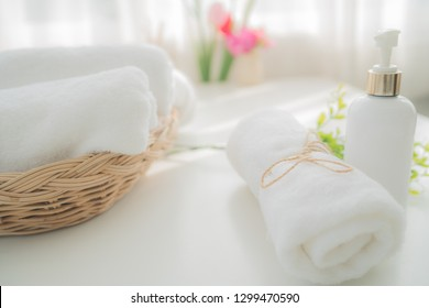 White towel with liquid soap bottle in bathroom. Hygiene and healthy life concept. Close up, selective focus