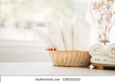 White towel on basket in bathroom. Hygiene and healthy life concept. Close up, selective focus