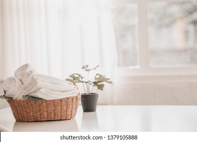 White towel on basket in living room. Hygiene and healthy life concept. Close up, selective focus
