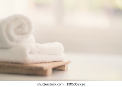 White towel on white desk in living room. Hygiene and healthy life concept. Close up, selective focus. For product display montage