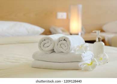 White towel roll and folded beautifully in luxury hotel room,Flowerpot, Liquid Soap, Spa