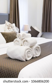 White towel roll on hotel resort bed