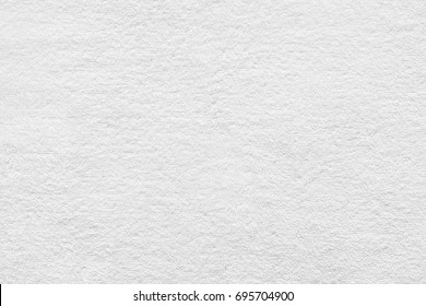 White towel texture for background. Flat and smooth with fabric or textile consist of cotton fiber material. Look plush, fluffy, dry, soft and clean. For background of baby, spa, hotel and laundry.