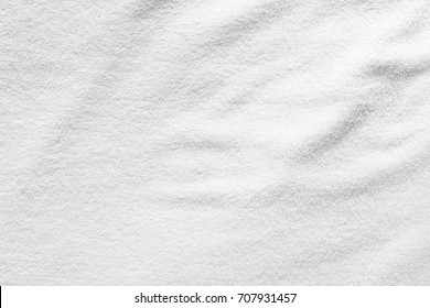White towel texture for background. That fabric or textile consist of cotton fiber material. Look plush, fluffy, dry, soft and clean.