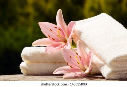 White towels with flower on green nature background