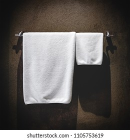 white towels hanging in the bathroom