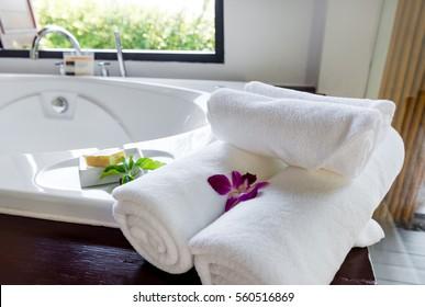 White towels on bathtub in hotel bathroom
