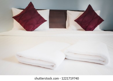white towels on bed with sun light