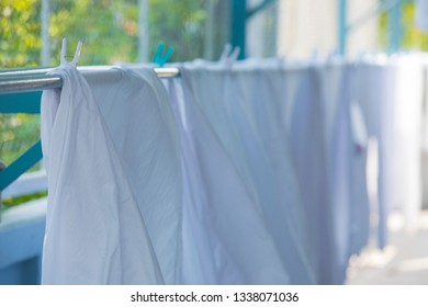White towels and sheets dry in the sun, Washing laundry ,clothes line,White clothes hung out to dry on a washing line
