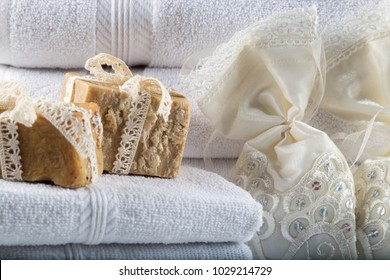 White towels with soaps on the white background.
