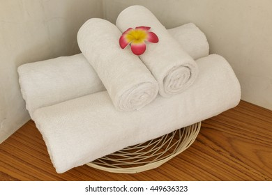 White towels were four pieces roll into a cylinder bosom placed in a basket bathroom and easy to use.