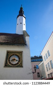 The white tower and old clock in the wall in old town of Tallinn Estonia Europe