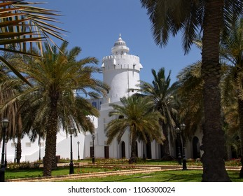 white tower surrounded by palms at Qasr Al Hosn palace in Abu Dhabi, United Arab Emirates
