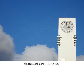 White town hall clock against blue sky background at Lower Hutt New Zealand