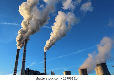 white toxic fume from coal power plant
