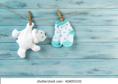 White toy bear and baby socks with stars print on a clothesline
