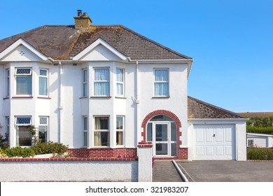 White traditional semi detached house view
