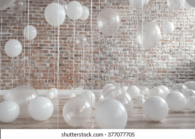 White And Transparent Balloons On Brick Wall Background