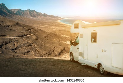 White travel caravan car stay on the beautifull ocean coastline with natural view in sunny day. Freedom, Family, Travell, Journej, Travelers concept.