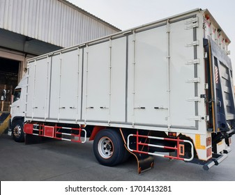 White truck cargo with lift parking at warehouse, road freight delivery logistics and transport.