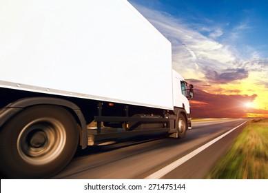 White truck on the asphalt rural road