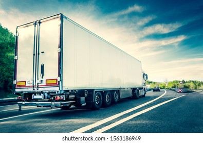 White truck on german highway with slight motion blur