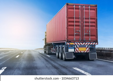 White Truck on highway road with red  container, transportation concept.,import,export logistic industrial Transporting Land transport on the asphalt expressway