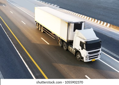 White Truck on highway road with container, transportation concept.,import,export logistic industrial Transporting Land transport on the expressway.motion blurred to soft focus