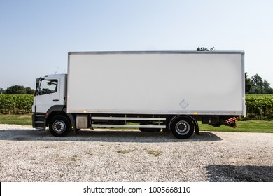 White truck in profile, copy space and countryside background
