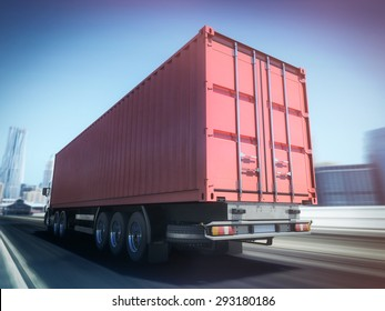 White truck with Red cargo container on blurry asphalt road with city