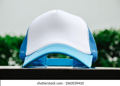White trucker cap with light blue without logo