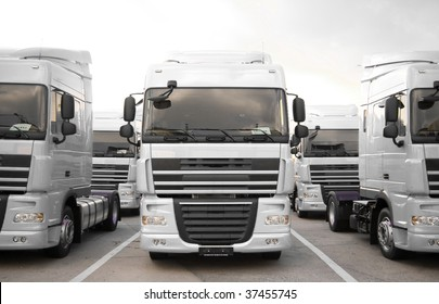 White trucks stand in line front view