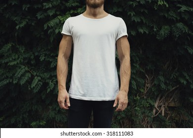 White t-shirt with copy space on a young man