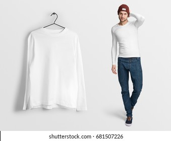 White t-shirt long sleeves, on a man in jeans and hat, isolated, mockup. Hanging t-shirt long sleeves, against empty wall background.