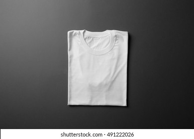 White T-Shirt Mock-up on black background, ready to replace your design
