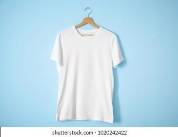 White t-shirt on color background. Mockup for design