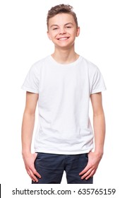 White t-shirt on teen boy. Handsome caucasian smiling child, isolated on a white background. Concept of childhood and fashion or advertisement design. Mock up template for design print.