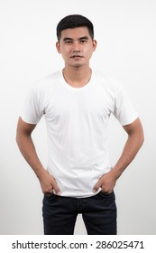 white t-shirt on a young man on white background