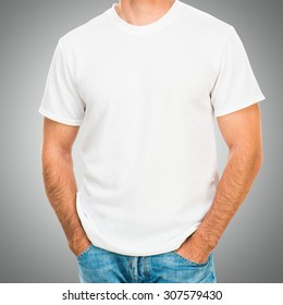 white tshirt on a young man template on gray background