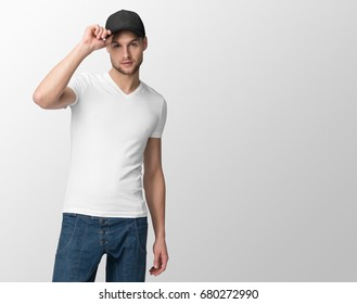 White t-shirt on a young man in jeans and baseball cap, isolated with copy space, mockup.