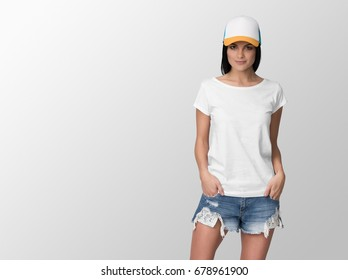White t-shirt on a young woman in shorts and white cap, isolated, with copy space, mockup.