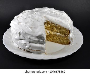 White two layer cake on black background