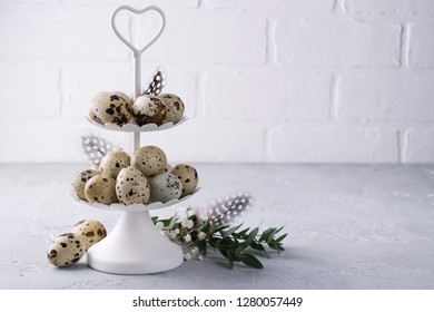 White two tier serving tray full of quail eggs. Happy Easter   day concept. Greeting card