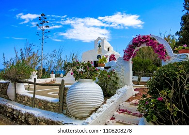 White typical greek chapel with blue sky in Crete Hersonissos at the open air museum